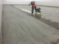 "Initial cut or ""grind"" of concrete floor."